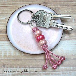 Schlüsselanhänger aus Paracord mit Perlen in rosa und pink