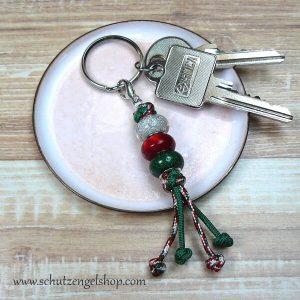 Schlüsselanhänger aus Paracord mit Perlen in weiß, rot und grün