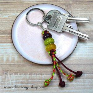 Schlüsselanhänger aus Paracord und Perlen in dunkelrot und neonfarben