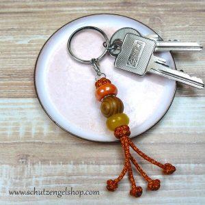 Schlüsselanhänger aus Paracord 2-farbig und 3 verschiedenen Perlen in gelb und orange