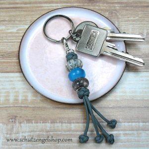 Schlüsselanhänger mit Paracord in grau und Perlen in grau und cyan