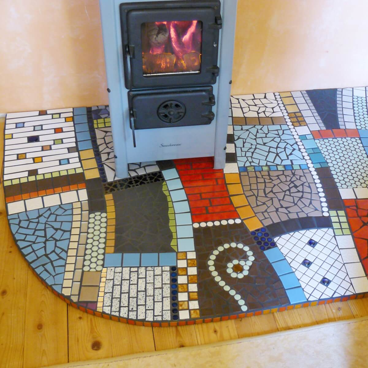 Ofenplatte mit Mosaik